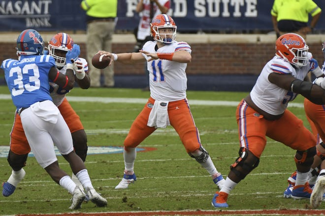Florida quarterback Kyle Trask (11) throwing six touchdown passes against Ole Miss should at least send a message to Heisman Trophy voters that Clemson's Trevor Lawrence isn't the only candidate worth considering for the award. (AP Photo/Thomas Graning)