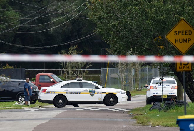 Jacksonville police block the road at Ken Knight Drive where an officer was shot outside a home on Rutledge Pearson Drive Monday morning, Sept. 28, 2020.