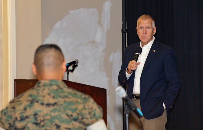U.S. Sen. Thom Tillis of North Carolina responds to a Marine during a town hall meeting at Marston Pavilion on Marine Corps Base Camp Lejeune, Aug. 15, 2019.