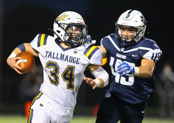 Tallmadge running back Cole Thomas looks for room during the Blue Deviles' 24-20 win at Twinsburg Sept. 25. Thomas ran for a pair of touchdowns in the win.
