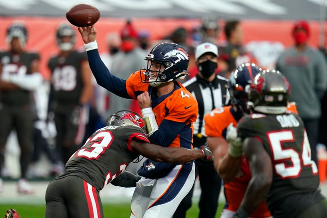 Denver Broncos quarterback Brett Rypien is hit by Tampa Bay Buccaneers free safety Jordan Whitehead as he throws a pass in the second half Sunday.