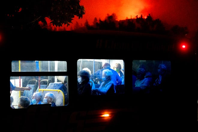 Residents of the Oakmont Gardens senior home evacuate on a bus as the Shady Fire approaches in Santa Rosa Calif., Monday, Sept. 28, 2020.