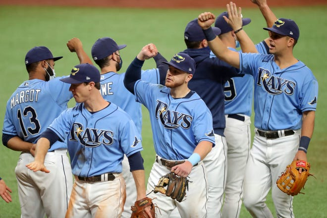 Members of the Tampa Bay Rays celebrate a 5-0 win over the Philadelphia Phillies.