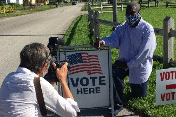 Felon William Freeman poses at a polling station. After voting rights groups and others paid his fines and restitution, Freeman will be able to vote in the general election for the first time