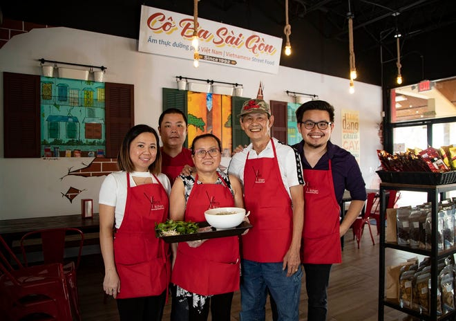 Family portrait at Yen's Kitchen, from left: Phuong Trac, Mike Du, Yen Nguyen, Hung Trac, Manh Trac. The Vietnamese restaurant is at 7364 Lake Worth Rd., Lake Worth Beach.