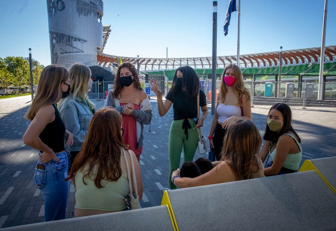 A group of first-year University of Oregon students meet Sept. 28, 2020, in Eugene, Oregon near Hayward Field as they acclimate to campus after arriving from Minnesota, California and Oregon. Some of the women said they knew each other but others were meeting for the first time