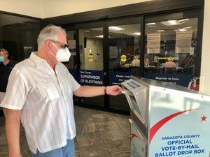 Sarasota Democrat Art Miller drops off his mail ballot on Sept. 28, 2020, at the Sarasota County Supervisor of Elections downtown office.