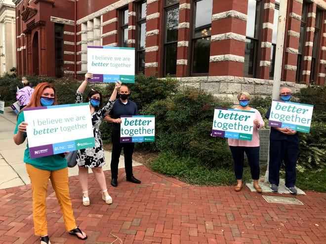 Supporters of a proposal to sell NHRMC to Novant Health gather outside the historic courthouse in downtown Wilmington on Monday prior to a public hearing on the proposal.