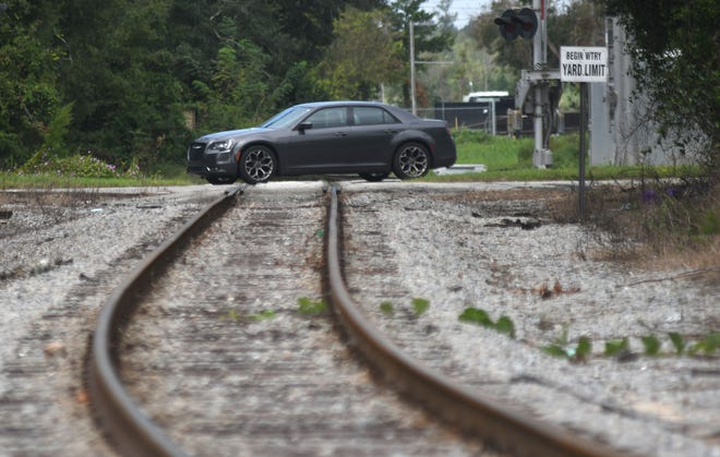 A car passes by over the railroad tracks at 3rd St. in Wilmington, N.C., Monday, September 28, 2020. The city of Wilmington is undertaking a study that will identify feasible alternatives that could be considered for the rail realignment project. The project aims to replace and improve the existing freight rail route between Navassa Yard and the Port of Wilmington.
