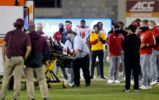 NC State safety Khalid Martin is put into an ambulance at midfield in the second half of Saturday's game at Virginia Tech. Martin was injured making a tackle and lay motionless on his back while medical personnel rushed to him. He returned to the team Monday with 'no radiographic abnormalities,' according to a school tweet.