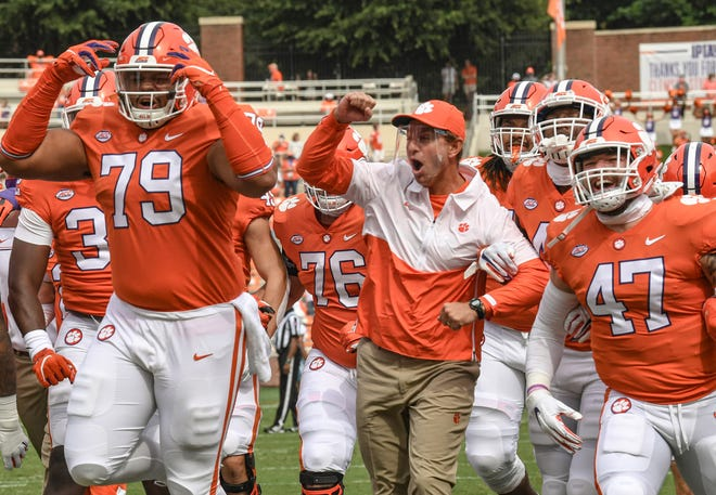 Clemson offensive tackle Jackson Carman (79), head coach Dabo Swinney, and linebacker James Skalski (47) react after the Walk of Champions before the game Saturday, Sept. 19, 2020 at Memorial Stadium in Clemson, S.C. (Ken Ruinard / Greenville News )