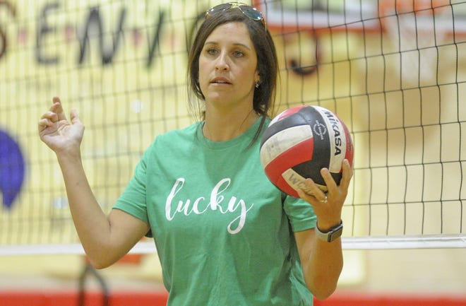 Hokes Bluff coach Haley Simmons helps her team warm up for a high school volleyball match against the Warriors at Westbrook Christian School on Thursday, Sept. 19, 2019.