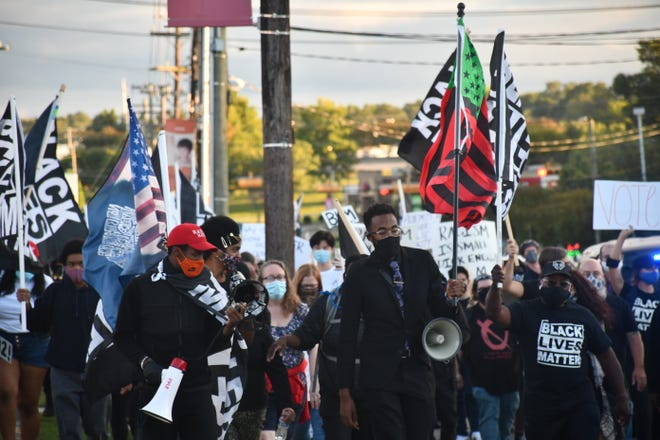 A group of protesters take part in a march on Saturday in Graham near a Confederate statue. [Photo: Dean-Paul Stephens/Times-News]
