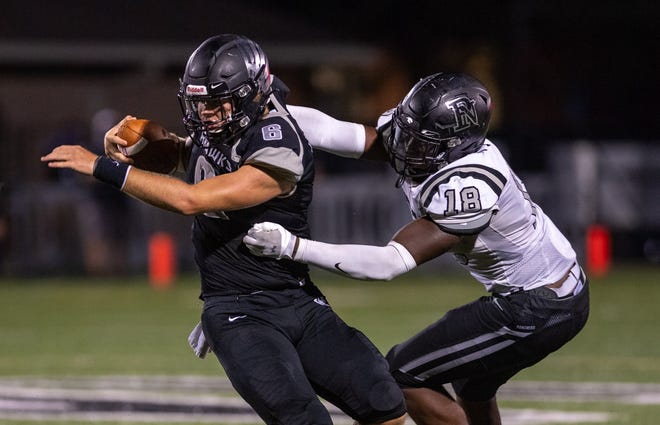 Pickerington North's Elijah Hawk (right) takles Westerville Central's Judah Holtzclaw on Sept. 4 at Central. Hawk has 17.5 tackles with one forced fumble, 1.5 sacks and two tackles for loss for the Panthers, who have won four in a row since losing the opener.