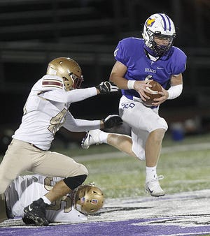 DeSales quarterback Whit Hobgood eludes Anthony DeFilippo (left) and Cole Graney of Watterson during a 35-34 double-overtime loss to the visiting Eagles on Sept. 18. Hobgood, a senior, is among several players who have stepped up as key contributors in a 4-1 start.
