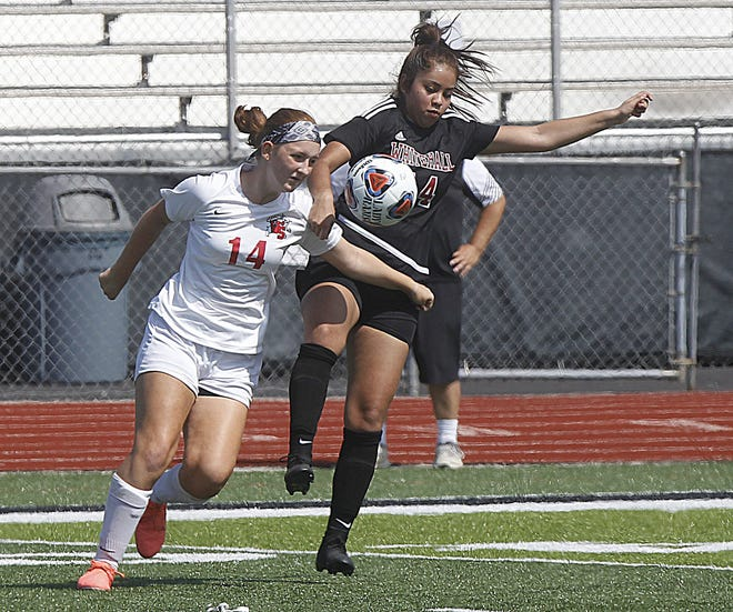 Westerville South's Alena Keenan and Whitehall's Abril Garcia (right) fight for the ball during their game Sept. 12 at Whitehall.