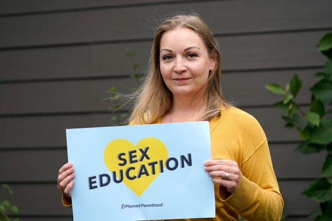 Courtney Normand, director of the Planned Parenthood-affiliated political group Safe & Healthy Youth Washington that is supporting a sex education requirement for public schools, poses for a photo Thursday, Sept. 24, 2020, in Arlington, Wash. Democrats in the famously liberal state say they want to protect young people from sexual abuse, diseases and infections. But the increasingly outnumbered and aggrieved Republicans have taken issue with the content of the standards as they rally for local control. The resulting referendum on the November ballot marks the first time in the country that such a decision on sex ed will be decided by voters.