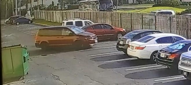 A dark red minivan is suspected of involvement in a hit-and-run that left a woman with serious injuries.