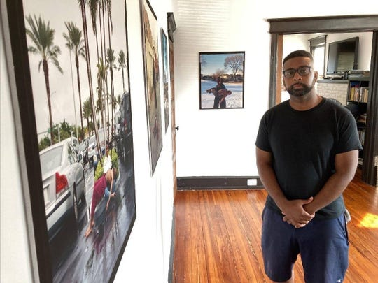 "Photographer Jon Henry is shown at his ""Stranger Fruit"" exhibit at Big Day Film Collective, a new gallery art space in Collingswood. His work was created in response to the ""senseless murders of black men across the nation by police violence,"" he says."
