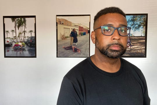 "Visual artist Jon Henry is shown at his ""Stranger Fruit"" exhibition which ran from Sept. 1-30 at Big Day Film Collective, a new gallery art space in Collingswood. His project depicts the modern day African American mother and child echoing the form of The Pieta and was created in response to the killing of unarmed Black men by police."