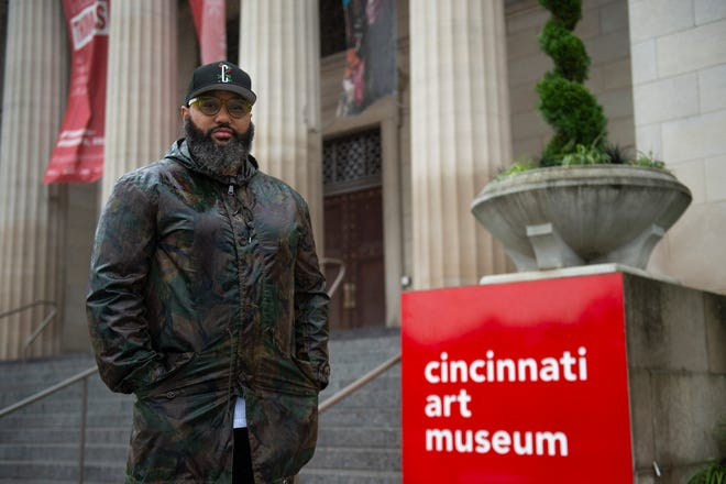 """Ricardo Grant poses for a portrait outside the Cincinnati Art Museum in Mount Adams on Monday, Sept. 28, 2020. Paloozanoire, Grant's event company, is hosting an exhibit """"Black and Brown Faces"""" alongside the current Hank Willis Thomas exhibit """"All Things Being Equal…"""" at the Cincinnati Art Museum."""