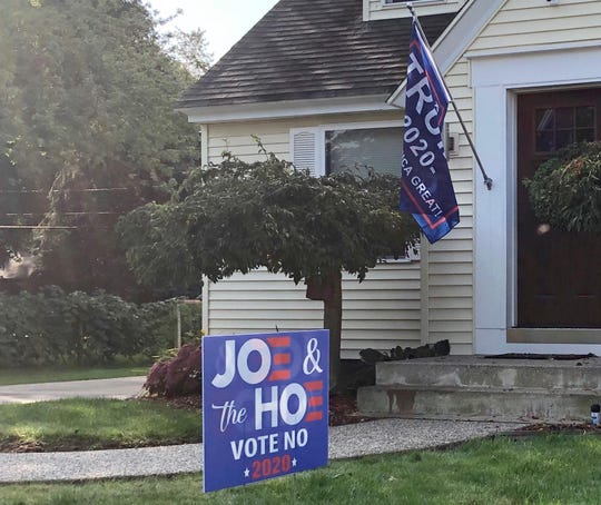 A political sign at the home of a Hudsonville business owner has sparked a controversy after the business responded explicitly to criticism over Facebook.
