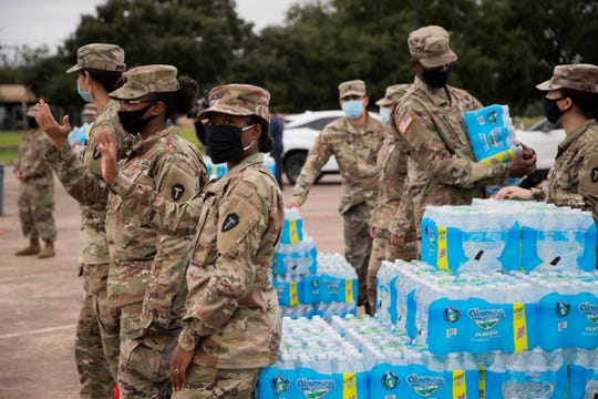 National Guard soldiers distribute bottled water to residents Monday, Sept. 28, 2020, in Lake Jackson, Texas.