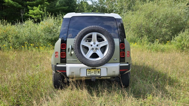 The rear of the 2020 Land Rover Defender is as distinctive as the front with its vertical taillights and spare tire.