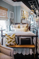 The intricate details of the spindles and the towering height of the headboard make a statement.