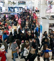 In this November 24, 2017, file image, Holiday shopping is in full swing as Black Friday shoppers make their way through Macy's in Manhattan, New York.