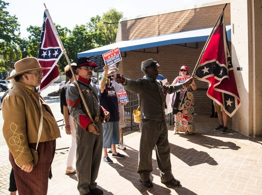 A group of protestors who support the Sons of the Confederacy gathered Monday, September 28, 2020 at the pedestal where the Robert E. Lee bust used to sit in downtown Fort Myers. The City of Fort Myers recently voted to keep the bust removed. The group was protesting to reverse that decision. The group also marched to Fort Myers City Hall and the Old Lee County Courthouse. They were joined by HK Edgerton, President of Southern Heritage 411, center.