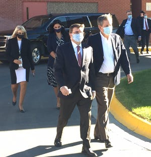 U.S. Department of Veterans Affairs Secretary Robert Wilkie walks out of the Fort Harrison VA Medical Center on Sept. 28 with Sen. Steve Daines, right.