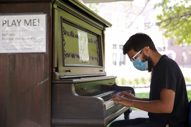 Talha Ahmad, a junior biomedical engineering student, plays a piano near the Purdue Bell Tower, Friday, Sept. 25, 2020 in West Lafayette.