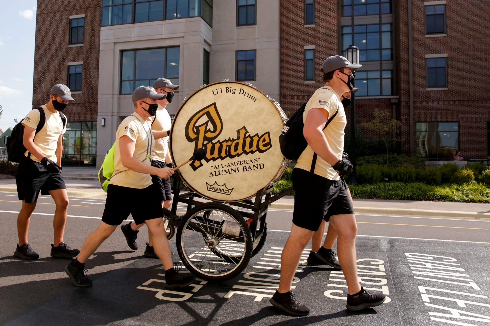 The Pudue University marching band's Li'l Big Drum is wheeled through West Lafayette on Friday.
