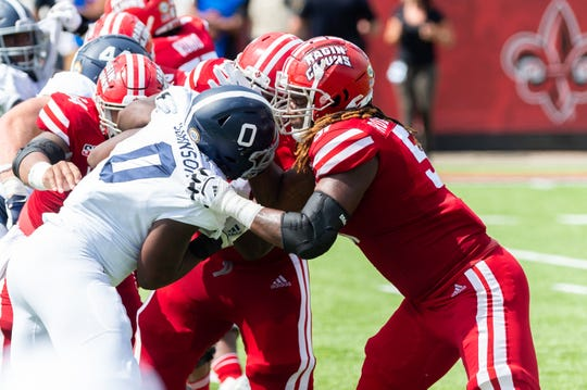 UL offensive lineman Zach Robertson (51, right) engages with Georgia Southern defensive end Raymond Johnson III during last Saturday's win over the Eagles at Cajun Field.