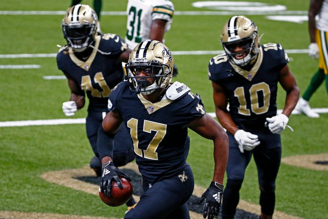 New Orleans Saints wide receiver Emmanuel Sanders (17) celebrates his touchdown reception in the first half of an NFL football game against the Green Bay Packers in New Orleans, Sunday, Sept. 27, 2020. (AP Photo/Butch Dill)