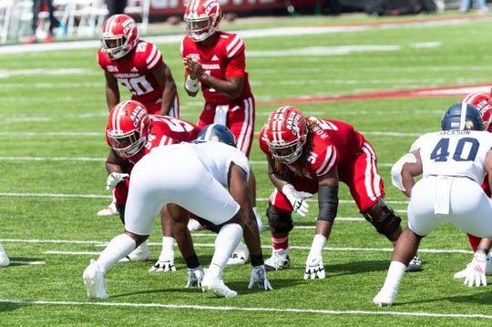 UL left tackle Zach Robertson (51, right) prepares for a snap during UL's 20-18 win over Georgia Southern on Saturday at Cajun Field.