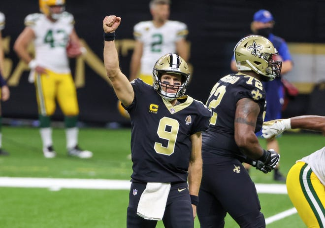 Sep 27, 2020; New Orleans, Louisiana, USA; New Orleans Saints quarterback Drew Brees (9) celebrates after a touchdown during the second quarter against the Green Bay Packers at the Mercedes-Benz Superdome. Mandatory Credit: Derick E. Hingle-USA TODAY Sports