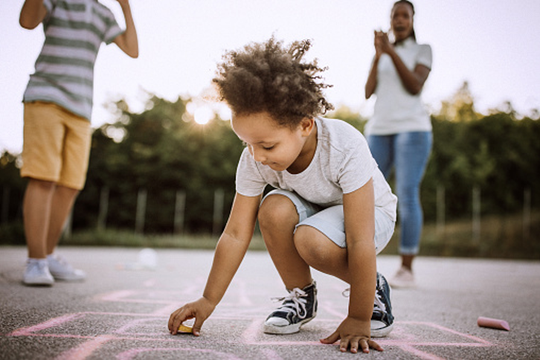 Active games like hopscotch can be fun for the whole family