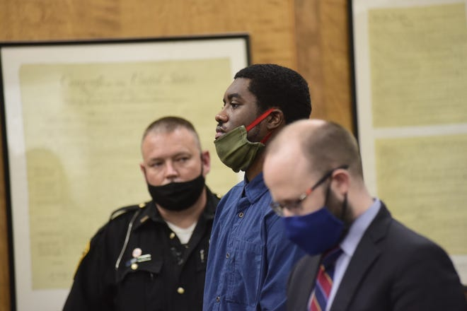 Chekiah Washington listens as guilty verdicts were read on all 18 of his charges Monday afternoon.