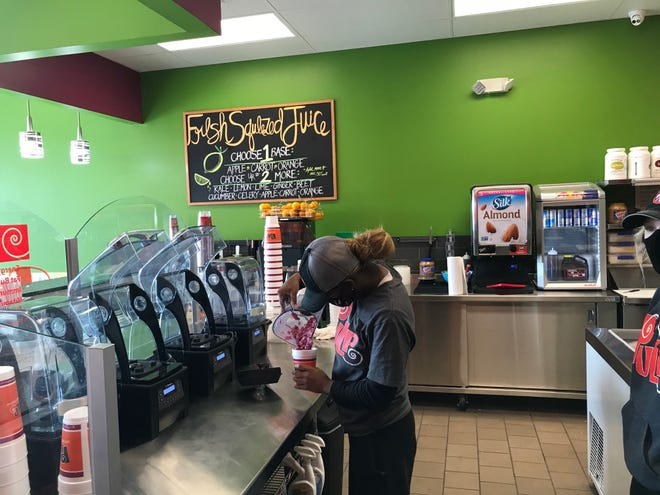 Zipporah Finley makes a Three-Berry Smoothie Monday  at Pulp Juice and Smoothie Bar, 994 N. Lexington-Springmill Road, Ontario. The new store, which opened Sept. 15, is owned by Adam Graber of Dalton.