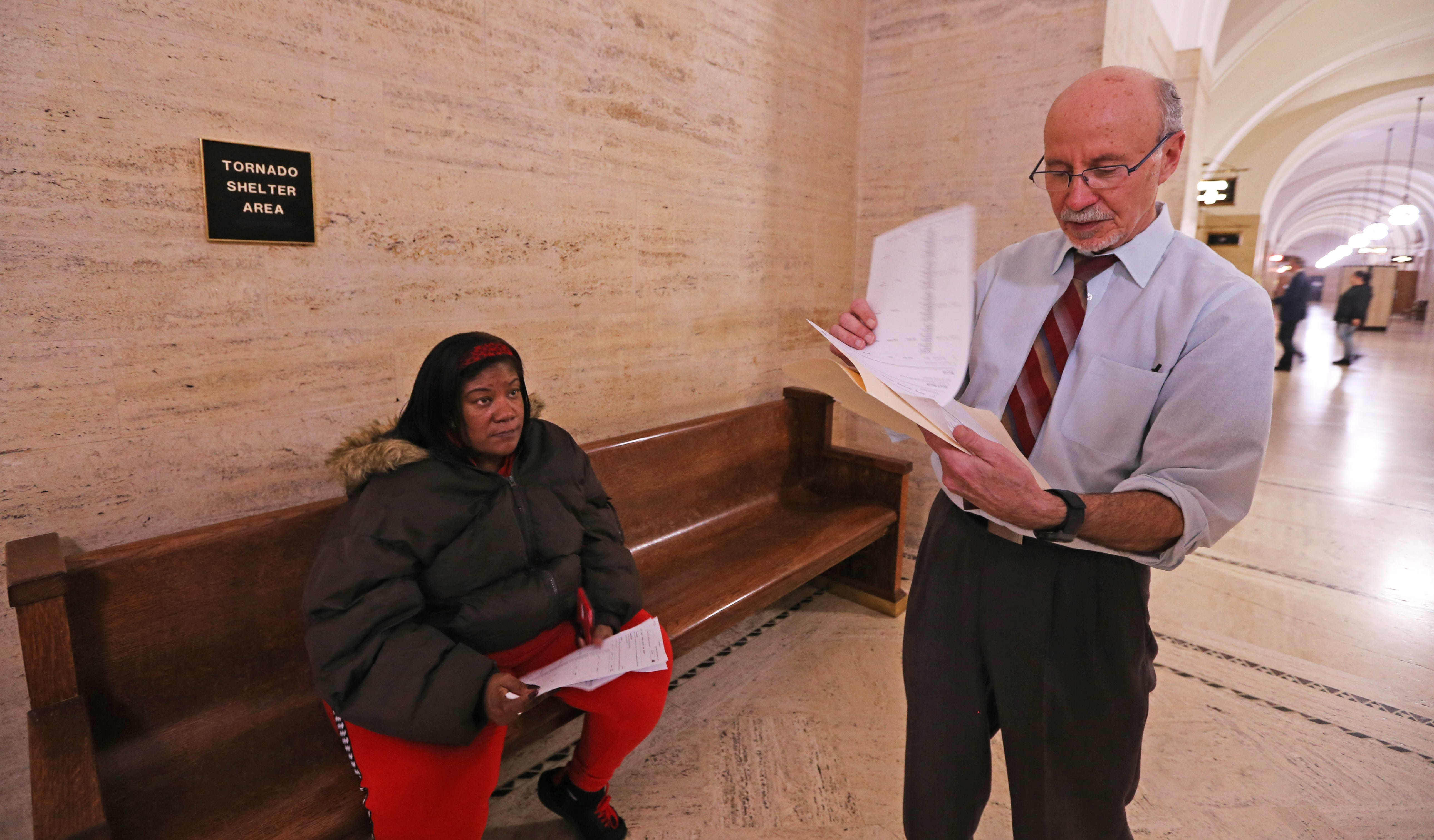 Christy  Conery, left, meets with eviction defense attorney Mark Silverman following her court case on Jan. 30, 2020. Judge Pedro Colón ruled in favor of the tenant and found that the landlord had not given a prior five-day right to cure notice.  Conery was not evicted, but moved out of the property a month later.