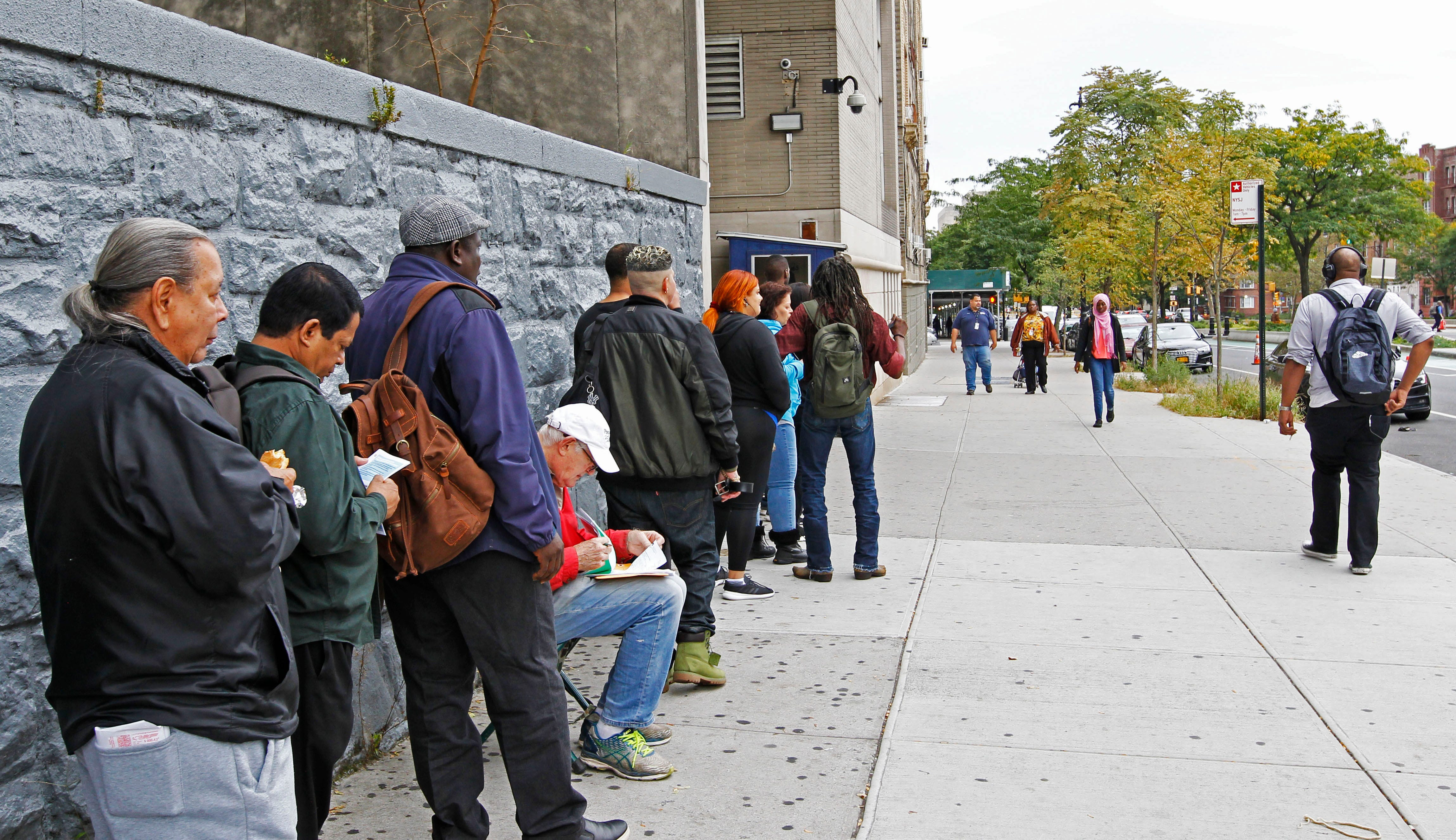 A morning crowd gathers outside the Bronx Housing Court on Monday, Oct. 7, 2019. New York City was the first in the nation to pass the right to counsel law in August 2017, guaranteeing legal representation to low-income residents facing eviction. The law won't be fully phased in until 2022 but is already having an effect in the court system. Prior to the pandemic, nearly 90,000 cases were heard yearly.
