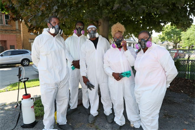 A crew from Sanitation & Disinfecting Service prepares for a COVID-19 cleaning at Community of Grace Baptist Church in Milwaukee in July. From left, Zeonte Robbins, Jeffery Hardy Jr., Jeffery B. Hardy Sr., Brenda Hardy, his wife, and daughter Breanna Hardy.