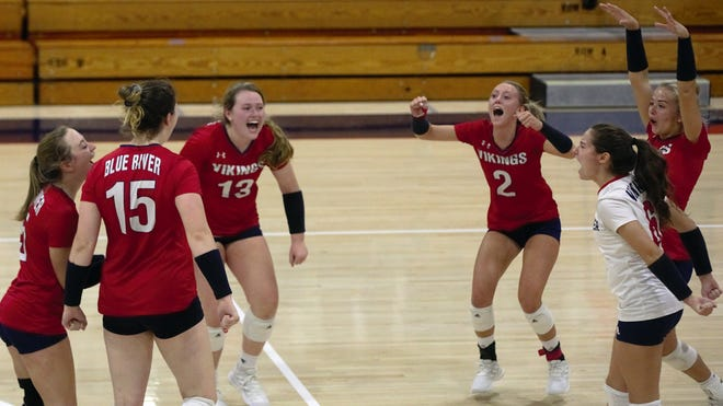 Blue River celebrates a point during a match against Cowan in the Class A Showdown at Blue River High School Saturday, Sept. 28, 2020.