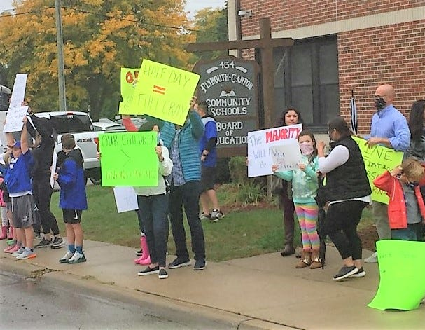 Approximately 50 protesters -- parents and students -- converged at the Plymouth-Canton Community Schools office Monday afternoon.