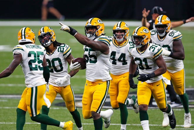 Green Bay Packers outside linebacker Za'Darius Smith (55) celebrates his fumble recovery in the second half of an NFL football game against the New Orleans Saints in New Orleans, Sunday, Sept. 27, 2020.