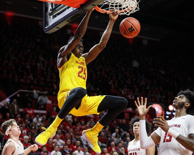 FILE - In this march 3, 2020, file photo, Maryland's Jalen Smith (25) dunks as Rutgers' Myles Johnson (15) watches during the first half of an NCAA college basketball game in Piscataway, N.J. Jalen Smith was selected to the Associated Press All-Big Ten team selected Tuesday, March 10, 2020. (AP Photo/John Minchillo, File).