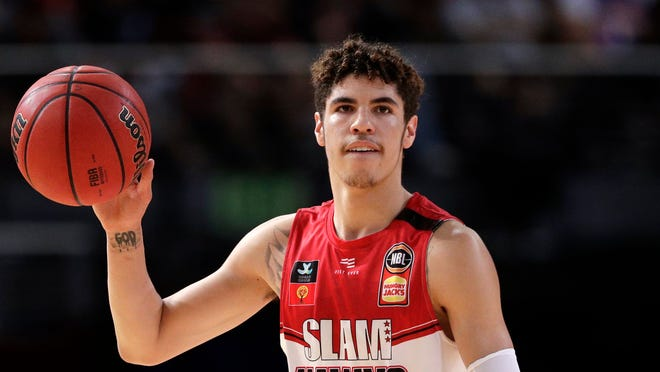 In this Nov. 17, 2019, file photo, LaMelo Ball of the Illawarra Hawks carries the ball up against the Sydney Kings in the Australian Basketball League in Sydney. Ball's bone bruise on his left foot kept him out of the Illawarra Hawks lineup for the remainder of the National Basketball League season in Australia. The 19-year-old American is expected to be a first-round pick in this year's NBA draft.(AP Photo/Rick Rycroft, File).