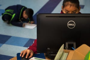 A second-grader works on a computer in her classroom at Hunters Point Boarding School in St. Michael's, Arizona, in December 2019. The Bureau of Indian Education has struggled to respond to the COVID-19 pandemic, and some of its schools started the year without enough computers for every student to learn online.